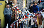 Minehead Hobby Horse Somerset. UK. Horse bows three times to young boy wearing old fashioned regulation National Health Service spectacles.