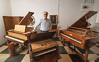 BNPS.co.uk (01202) 558833<br /> Pic: ZacharyCulpin/BNPS<br /> <br /> Pictured: The sale includes pianos of all shapes and sizes<br /> <br /> A remarkable collection of rare pianos belonging to the Queen's personal restorer and conservator has emerged for sale for £250,000.<br /> <br /> David Winston is parting with 26 pianos he has amassed over the past 30 years dating from the 18th century to the present day.<br /> <br /> Mr Winston, who was awarded the Royal Warrant in 2012, is regarded as one of the foremost experts in his field and has restored pianos owned and played by Beethoven, Chopin and Liszt.<br /> <br /> His collection includes a 1925 Pleyel grand piano fitted with an original 'Auto Pleyela' self-playing mechanism in a spectacular Chinoiserie Louis XV case valued at 60,000.