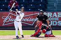Kevin Medrano (13) of the Missouri State Bears follows through his swing during a game against the Southern Illinois University- Edwardsville Cougars at Hammons Field on March 10, 2012 in Springfield, Missouri. (David Welker / Four Seam Images)