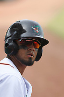 Down East Wood Ducks outfielder Eduard Pinto (4) on deck during a game against the Salem Red Sox at Grainger Stadium on April 16, 2017 in Kinston, North Carolina. Salem defeated Down East 9-2. (Robert Gurganus/Four Seam Images)