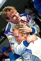 22-25 January, 2009, Daytona Beach, Florida USA.Darren Law gets a hug from teammate Antonio Garcia as their #58 crosses the finishline..©F.Peirce Williams 2009.F.Peirce Williams.photography