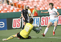 Erin McLeod #18 of Washington Freedom makes a save in front of Megan Rapinoe #8 of the Chicago Red Stars during a WPS match at RFK stadium on June 13 2009 in Washington D.C. The game ended in a 0-0 tie.