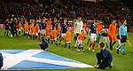 Scotland walk past the Saltire flag and line up in front of the Dutch flag by mistake