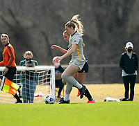 LOUISVILLE, KY - MARCH 13: Katie McClure #22 of Racing Louisville FC fights for possession during a game between West Virginia University and Racing Louisville FC at Thurman Hutchins Park on March 13, 2021 in Louisville, Kentucky.