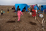 ARBAT, IRAQ: Syrian women dig holes for posts for a shelter in the Arbat refugee camp...45 families who have fled the violence in Syria are currently living in the Arbat refugee camp 19km outside the Iraqi city of Sulaimaniyah...Photo by Zmnako Ismael/Metrography