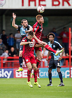 Matt Harrold of Crawley Town wins the header during the Sky Bet League 2 match between Crawley Town and Wycombe Wanderers at Checkatrade.com Stadium, Crawley, England on 29 August 2015. Photo by Liam McAvoy.
