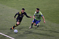 COLUMBUS, OH - DECEMBER 12: Lucas Zelarayan #10 of the Columbus Crew is chased by Cristian Roldan #7 of the Seattle Sounders FC during a game between Seattle Sounders FC and Columbus Crew at MAPFRE Stadium on December 12, 2020 in Columbus, Ohio.