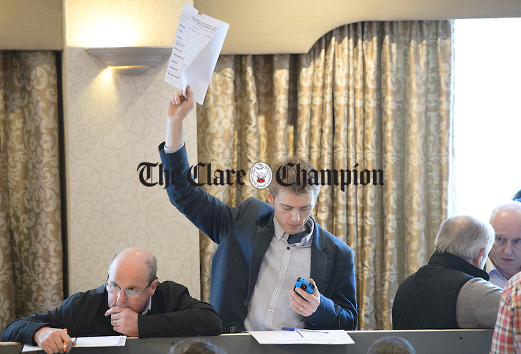 A tallyman calls on a colleague at the Clare General Election count in the Falls Hotel, Ennistymon. Photograph by John Kelly.