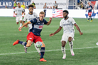FOXBOROUGH, UNITED STATES - AUGUST 20: Matt Real #32 of Philadelphia Union and Mark McKenzie #4 of Philadelphia Union move in to defend as Adam Buksa #9 of New England Revolution approaches the goal during a game between Philadelphia Union and New England Revolution at Gilette on August 20, 2020 in Foxborough, Massachusetts.