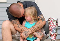 Joel Klobnak, 24, hugs his daughter, Grace, 3, outside his Greenfield home.  He lost his leg and developed PTSD during a tour of Iraq with the Marines in 2006.  He's now caught in bureaucratic red tape that has forced him to wait two years to find out if he qualifies for full disability.  His frustrations are part of a national scandal over delays in the VA's system for determining who deserves disability pay for their wartime injuries and mental issues. Klobnak is trying to support a family of four on the $1,500 per month the VA is sending him for partial disability while his appeal is pending.