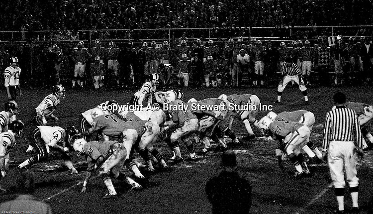 Bethel Park PA:  Offensive play with the Bethel Park offense ready to run a play.  Others in the photo; Bruce Evanovich 80, Jim Dingeldine 73, Glenn Eisaman, Don Troup 51, Dennis Franks 66, Joe Barrett 75, Gary Biro 81, Chip Huggins 32, Clark Miller 30, Mike Stewart 11. The Bethel Park defense recovered 5 fumbles but the offense was not able to score against the Mt Lebanon Defense.  The field conditions were horrendous, after every play you had to get the sawdust out of your eyes. After a highly disputed non-TD call by Art Walker's brother-in-law, the undefeated Mt Lebanon Blue Devils ended up winning the Western Conference.  The defensive unit was one of the best in Bethel Park history only allowing a little over 7 points a game.