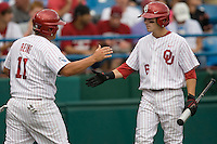 Oklahoma's Cody Reine celebrates with Eric Ross in Game 3 of the NCAA Division One Men's College World Series on Sunday June 20th, 2010 at Johnny Rosenblatt Stadium in Omaha, Nebraska.  (Photo by Andrew Woolley / Four Seam Images)