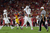 LOS ANGELES, CA - SEPTEMBER 11: Ricky Miezan #45 of the Stanford Cardinal congratulates Gabe Reid #90 after a tackle during a game between University of Southern California and Stanford Football at Los Angeles Memorial Coliseum on September 11, 2021 in Los Angeles, California.
