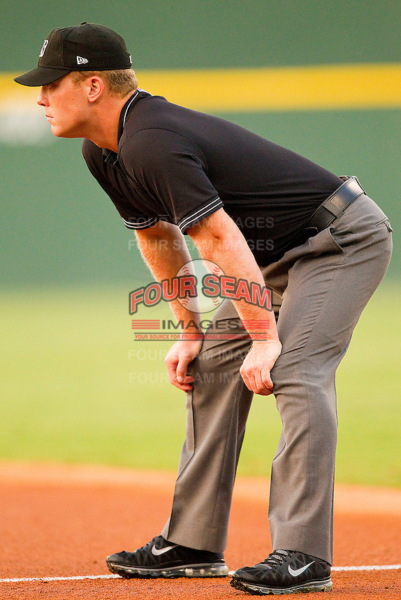 First base umpire Toby Basner during the International League game between the Pawtucket Red Sox and the Charlotte Knights at Knights Stadium on August 11, 2011 in Fort Mill, South Carolina.  The Red Sox defeated the Knights 3-2.   (Brian Westerholt / Four Seam Images)