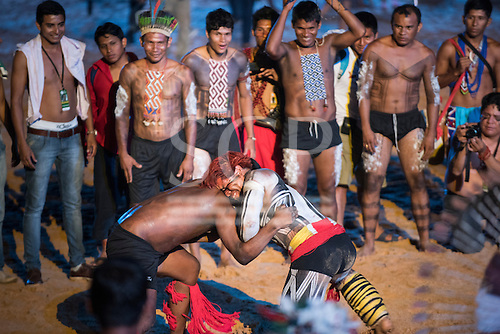 Karaja and Kuikuro warriors wrestle during a Huka-Huka at the opening ceremony in the Green Arena at the first ever International Indigenous Games, in the city of Palmas, Tocantins State, Brazil. Photo © Sue Cunningham, pictures@scphotographic.com 23rd October 2015