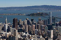 aerial photograph of the San Francisco financial district skyline, San Francisco, California; the TransAmerica Pyramid, left, 555 California St formerly known as the Bank of America tower, center and the Salesforce Tower, right; Treasure Island and the Bay Bridge in the background