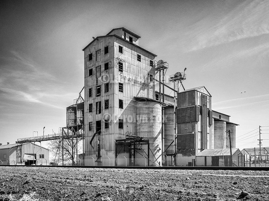 Abandoned grain elevator along the railroad track, San Joaquin, California