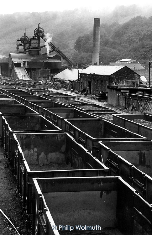 Coal trucks wait to be loaded at a pit in the Welsh valleys. The South Wales valleys used to employ 250,000 miners in 400 pits.
