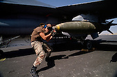 Al Batin, Saudi Arabia<br /> February 14, 1991<br /> <br /> American F-15 fighter planes are loaded with 2,000 pound bombs to be used on targets in Iraq and Kuwait at King Khalid Military City -KKMC or Emerald City.