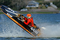 Frame 5: Bruce Hansen (44-W) blows over in a turn then turns upright after landing.....Stock  Outboard Winter Nationals, Ocoee, Florida, USA.13/14 March, 2010 © F.Peirce Williams 2010