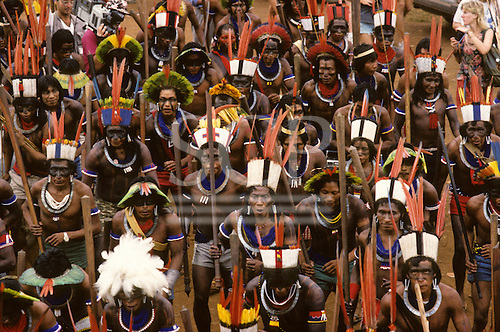 Altamira, Para State, Brazil. Indians in colourful feather headdresses; Kayapo, Arara, protesting against dam construction. Altamira Gathering, 1989.