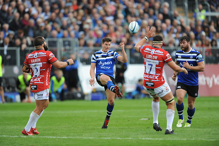 Freddie Burns of Bath Rugby chips into the corner over the head of Lewis Ludlow of Gloucester Rugby during the Gallagher Premiership Rugby match between Bath Rugby and Gloucester Rugby at The Recreation Ground on Saturday 8th September 2018 (Photo by Rob Munro/Stewart Communications)