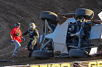 Dec. 10, 2011; Chandler, AZ, USA;  LOORRS pro two unlimited driver Robby Woods climbs from his truck after flipping during round 15 at Firebird International Raceway. Mandatory Credit: Mark J. Rebilas-