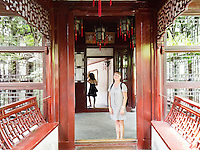 Isabelle in a doorway in Yu Gardens.  Yu Gardens, a peaceful place to escape the bustle of Shanghai.  Full of visitors, still very calming.  Details in the buildings, doors and stone sculptures.  Helps get your Ying and Yang in balance.