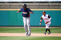 Toledo Mudhens pinch runner Jordany Valdespin (24) leads off second base in front of shortstop Wilfredo Tovar during a game against the Rochester Red Wings on June 12, 2016 at Frontier Field in Rochester, New York.  Rochester defeated Toledo 9-7.  (Mike Janes/Four Seam Images)
