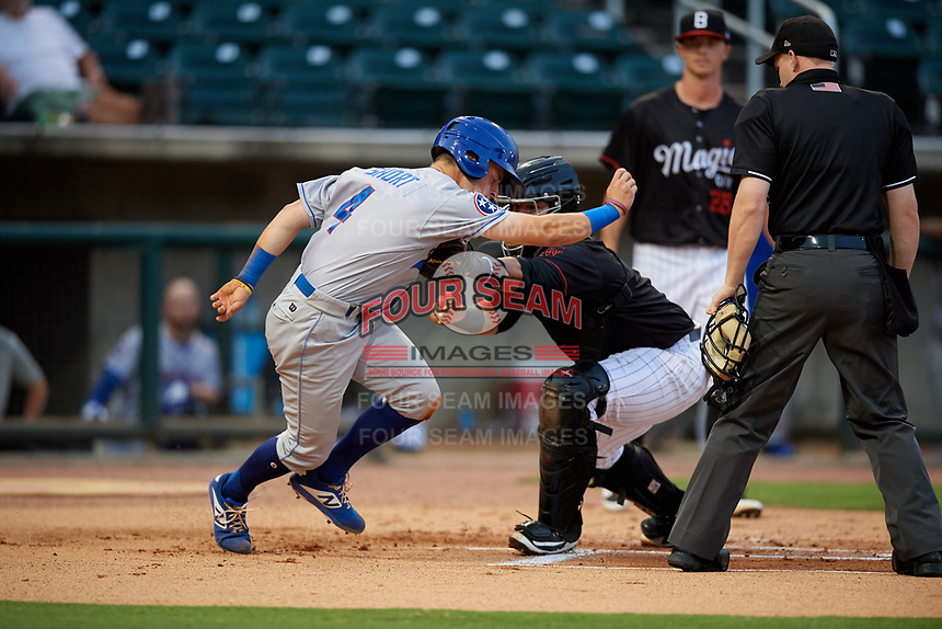 Birmingham Barons catcher Alfredo Gonzalez (1) tags Zack Short (4) as home plate umpire Chase Eade and starting pitcher Ian Clarkin (28) look on during a game against the Tennessee Smokies on August 16, 2018 at Regions FIeld in Birmingham, Alabama.  Tennessee defeated Birmingham 11-1.  (Mike Janes/Four Seam Images)