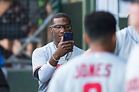AFL East second baseman Shed Long (6), of the Salt River Rafters and the Cincinnati Reds organization, takes a video on his cell phone in the dugout during the Arizona Fall League Fall Stars game at Surprise Stadium on November 3, 2018 in Surprise, Arizona. The AFL West defeated the AFL East 7-6 . (Zachary Lucy/Four Seam Images)