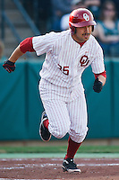Tyler Ogle (35) runs to first after hitting during the NCAA matchup between the University of Arkansas-Little Rock Trojans and the University of Oklahoma Sooners at L. Dale Mitchell Park in Norman, Oklahoma; March 11th, 2011.  Oklahoma won 11-3.  Photo by William Purnell/Four Seam Images