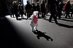 Fourteen-month-old Ellie Englund watches her bunny-outfitted shadow at the Easter Day Parade on 5th ave. between 49th and 57th st. on March 23, 2008 in New York, New York. The parade attracted hundreds of people who wanted to show off their Easter garb. (Photo by Yana Paskova/Getty Images)