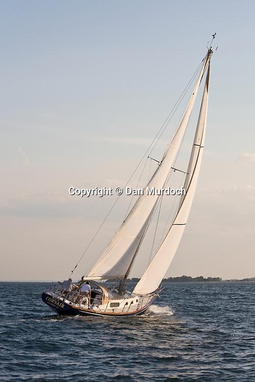 sailboat heading towards island