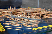 BNPS.co.uk (01202) 558833<br /> Pic: ZacharyCulpin/BNPS<br /> <br /> Pictured: The stages of how the models are made are part of Philip Warren's new exhibition at the Nothe Fort in Weymouth<br /> <br /> A master modeller who was inundated with hundreds of rare matchboxes after appealing for donations has used them to build a 3ft long aircraft carrier.<br /> <br /> Now Philip Warren has added the impressive model to his so-called matchbox fleet of miniature ships which have gone on display in an exhibition.<br /> <br /> Mr Warren's 72 year pastime of building model warships had looked as though it had come to an end earlier this year when he ran out of the traditional wooden boxes he used to make the hull and decks.<br /> <br /> But the 90-year-old was sent more than 300 of the lightweight matchboxes made from aspen wood in response to his plea for more.