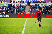 Groundsman half time fork<br /> Re: Behind the Scenes Photographs at the Liberty Stadium ahead of and during the Premier League match between Swansea City and Bournemouth at the Liberty Stadium, Swansea, Wales, UK. Saturday 25 November 2017