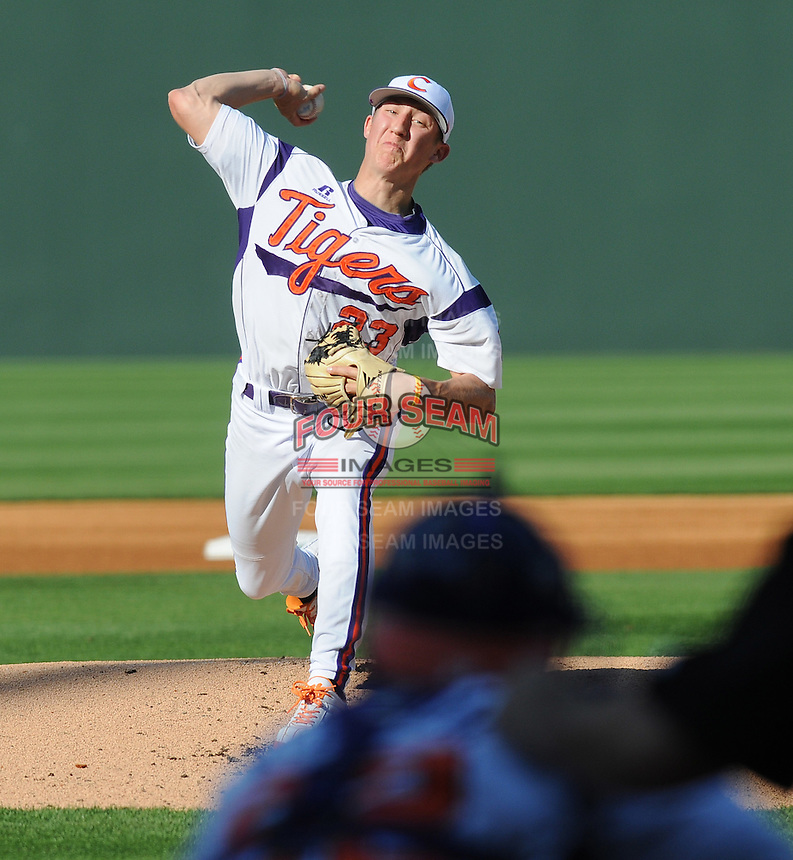 Starting pitcher Daniel Gossett (23) of the Clemson Tigers pitches against the Elon College Phoenix on March 21, 2012, at Fluor Field at the West End in Greenville, South Carolina. Clemson's 4-2 win was Gossett's first college win and head coach Jack Leggett's 1,200th career win. (Tom Priddy/Four Seam Images)