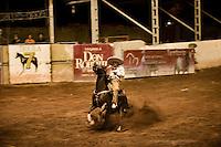 Mexico, Cowboys at Charreada rodeo.
