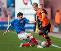 Gers Sebastian Faure challenges United's Gary Mackay Steven.