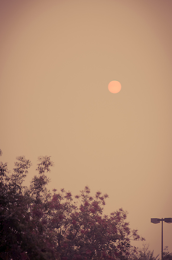 Because of multiple fires in California, the sun this afternoon had a reddish hue. It's also very smoky that the air was hard to breathe when I took this shot in Elk Grove.