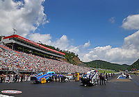 Jun 21, 2015; Bristol, TN, USA; Overall view of Bristol Dragway as NHRA funny car driver Tommy Johnson Jr (left) wait alongside Tim Wilkerson for their turn in front of the grandstands during the Thunder Valley Nationals. Mandatory Credit: Mark J. Rebilas-