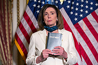 Nancy Pelosi Holds Bible Following Enrollment Ceremony