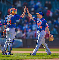 21 April 2013: New York Mets infielder Daniel Murphy gets a high-five from catcher John Buck after a game against the Washington Nationals at Citi Field in Flushing, NY. The Mets shut out the visiting Nationals 2-0, taking the rubber match of their 3-game weekend series. Mandatory Credit: Ed Wolfstein Photo *** RAW (NEF) Image File Available ***