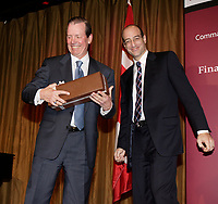 """Tony Comper, President and Chief<br /> Executive Officer of BMO Financial Group and co-founder of FAST (Fighting Antisemitism Together) receive a gift after he address the Canadian Club of Montreal on  """"Why non-Jews must confront antisemitism"""", September 11 2006.<br /> Photo by Pierre Roussel / Images Distribution"""