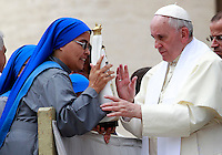 Papa Francesco saluta un gruppo di suore al termine dell'udienza generale del mercoledi' in Piazza San Pietro, Citta' del Vaticano, 10 settembre 2014.<br /> Pope Francis blesses a statuette of St. Mary as he greets some nuns at the end of his weekly general audience in St. Peter's Square at the Vatican, 10 September 2014.<br /> UPDATE IMAGES PRESS/Isabella Bonotto<br /> <br /> STRICTLY ONLY FOR EDITORIAL USE