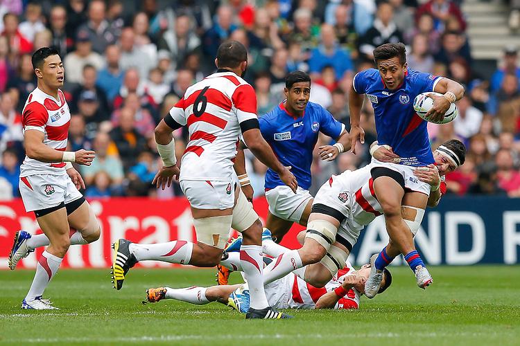 Samoa Full Back Tim Nanai-Williams is tackled by Japan Lock Luke Thompson - Mandatory byline: Rogan Thomson - 03/10/2015 - RUGBY UNION - Stadium:mk - Milton Keynes, England - Samoa v Japan - Rugby World Cup 2015 Pool B.