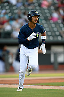 Third baseman Mark Vientos (13) of the Columbia Fireflies runs out a batted ball in a game against the Lexington Legends on Friday, May 3, 2019, at Segra Park in Columbia, South Carolina. Lexington won, 5-2. (Tom Priddy/Four Seam Images)