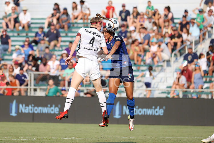 CARY, NC - SEPTEMBER 12: Lynn Williams #9 of the North Carolina Courage and Becky Sauerbrunn #4 of the Portland Thorns FC challenge for a header during a game between Portland Thorns FC and North Carolina Courage at Sahlen's Stadium at WakeMed Soccer Park on September 12, 2021 in Cary, North Carolina.