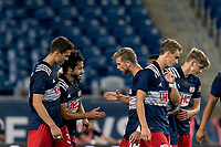 FOXBOROUGH, MA - JULY 23: Ryan Spaulding #34 of New England Revolution II celebrates goal with teammates during a game between Toronto FC II and New England Revolution II at Gillette Stadium on July 23, 2021 in Foxborough, Massachusetts.