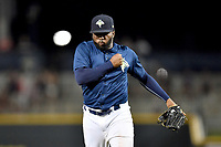 Pitcher Adonis Uceta (30) of the Columbia Fireflies shouts after getting the final out in a game against the West Virginia Power on Thursday, May 18, 2017, at Spirit Communications Park in Columbia, South Carolina. Columbia won in 10 innings, 3-2. (Tom Priddy/Four Seam Images)